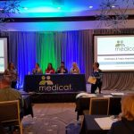 Medicat Event in Atlanta - Blue green lighting in the background in a conference room